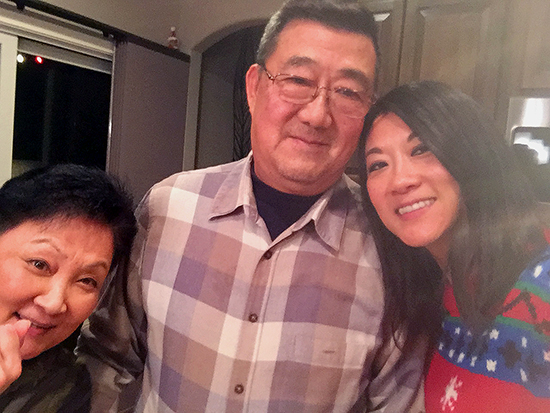 Ming Wang with his wife Lu Wang, left, and daughter Anne Peterson, right.