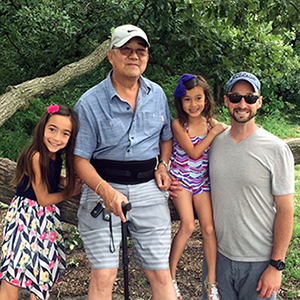 Ming Wang with two of his grandchildren and his son-in-law Dean Peterson. He has seven grandchildren total.
