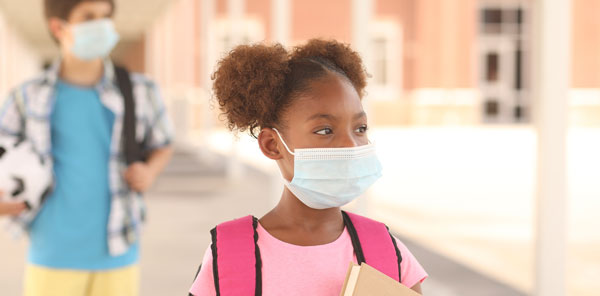 Young girl at school with a fask mask